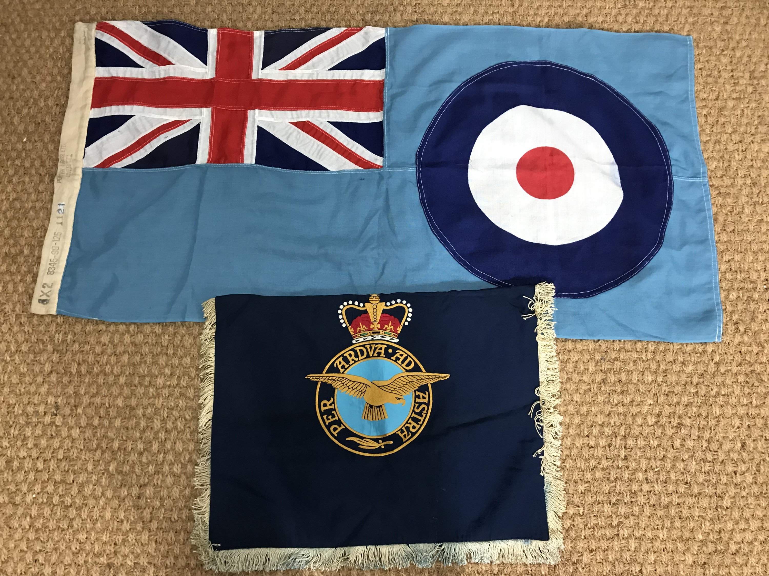 Lot 59 - A post 1952 RAF banner together with an RAF ensign / flag