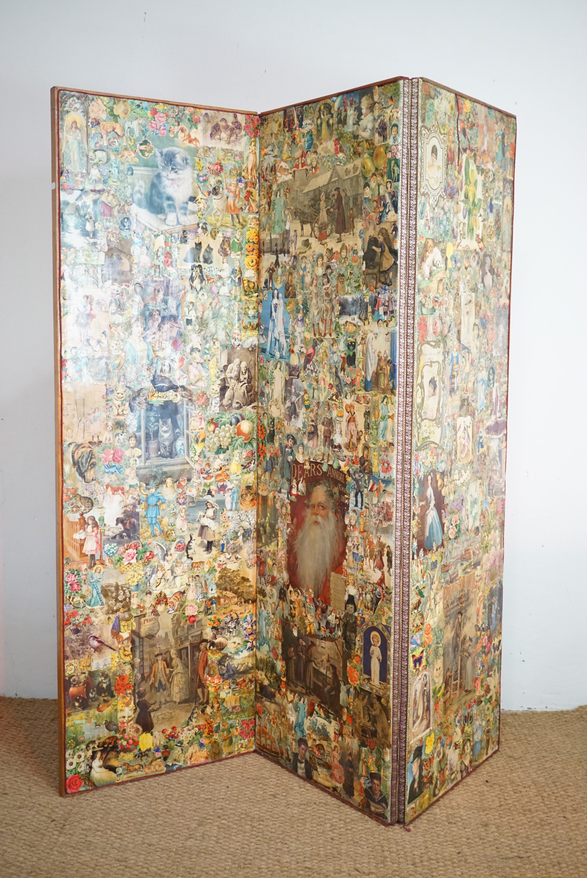Lot 771 - A late Victorian decoupage two-fold screen, 185 cm high