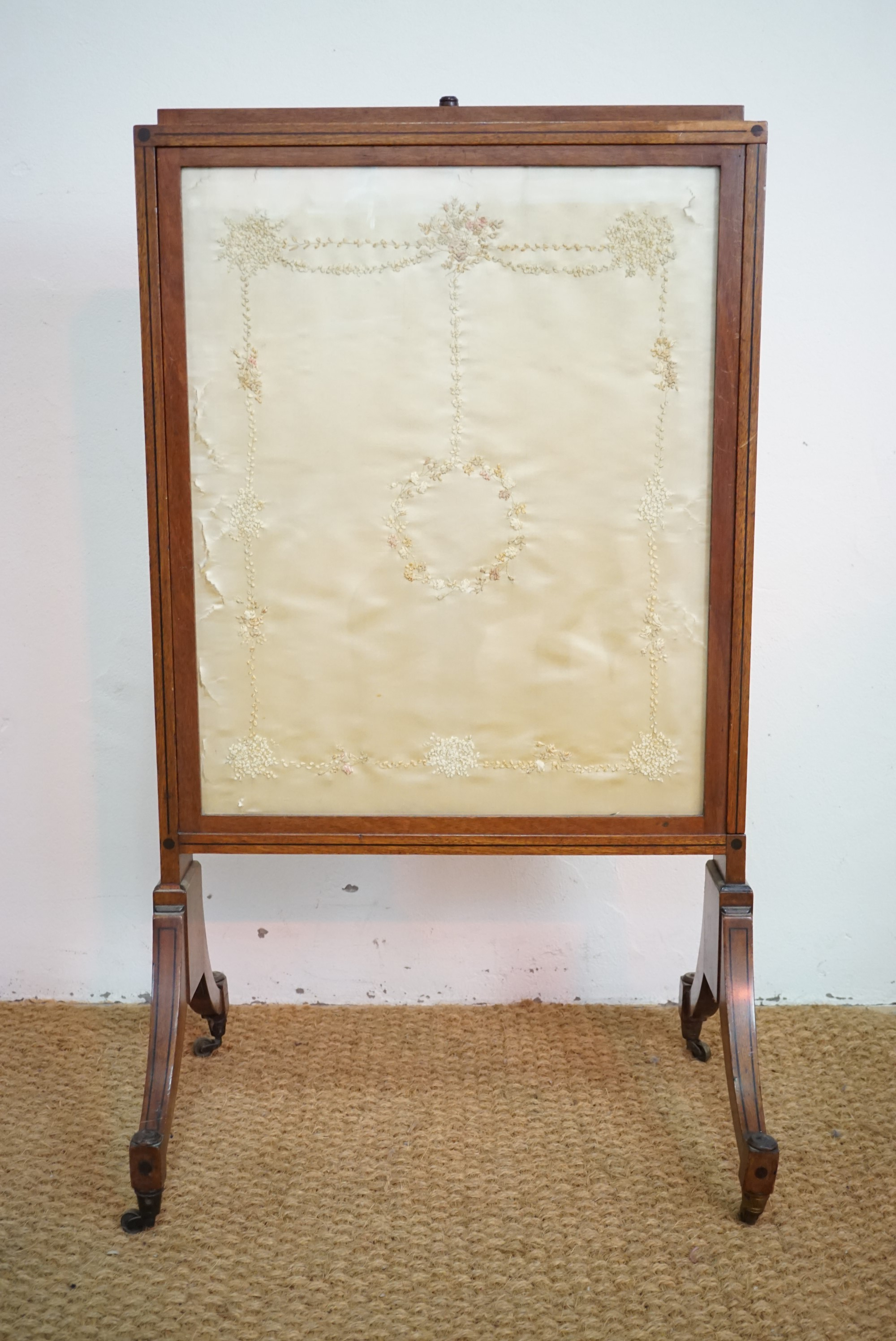 Lot 781 - An early 19th Century height-adjustable mahogany fire screen with extending sides