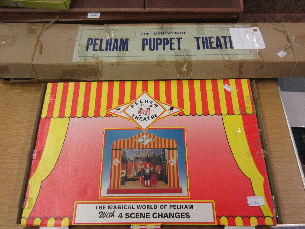 Lot 291 - Early lightweight Pelham puppet theatre in original box, together with a later Pelham puppet theatre