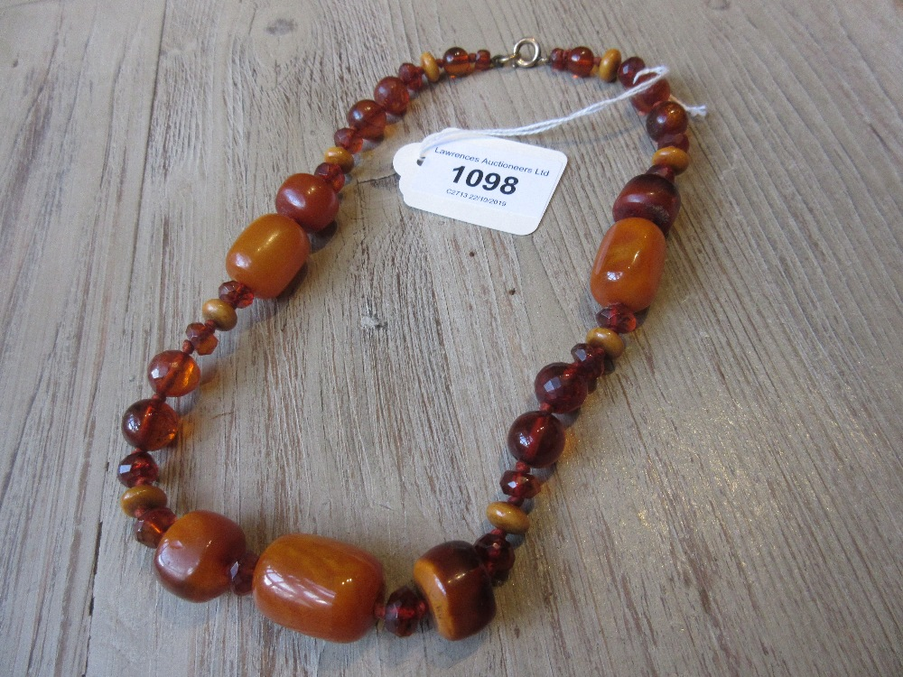 Lot 1098 - Faceted bead and amber necklace