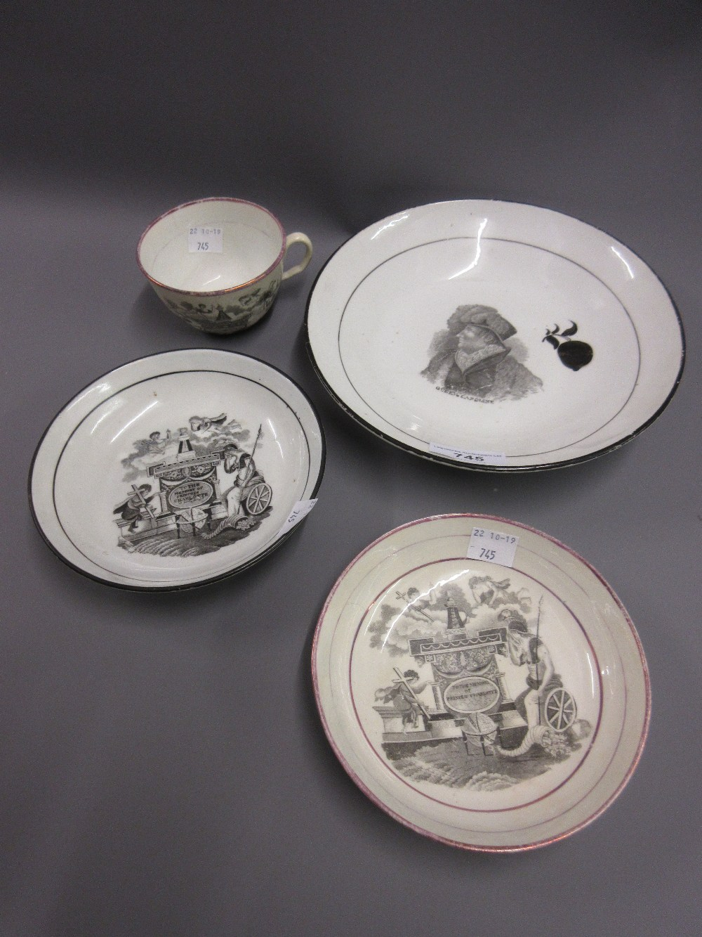 Lot 745 - Regency bat ?? printed commemorative cup and saucer for the death of Princess Charlotte 1817,