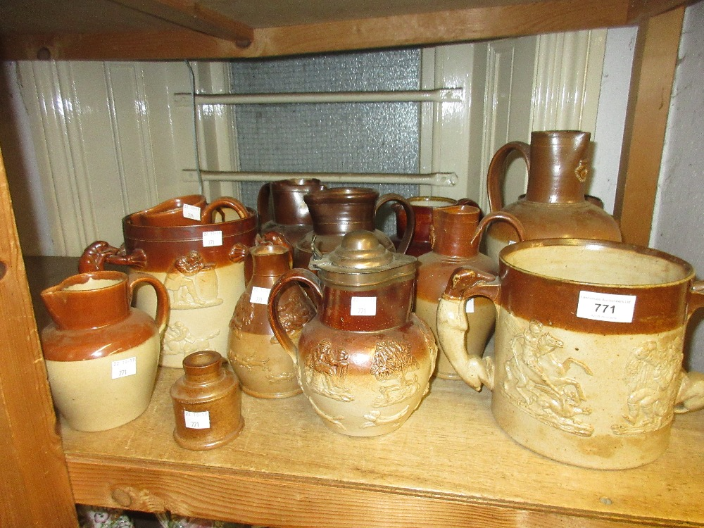 Lot 771 - Quantity of salt glazed stoneware mugs and jugs Loving Cup on right side of picture - good condition