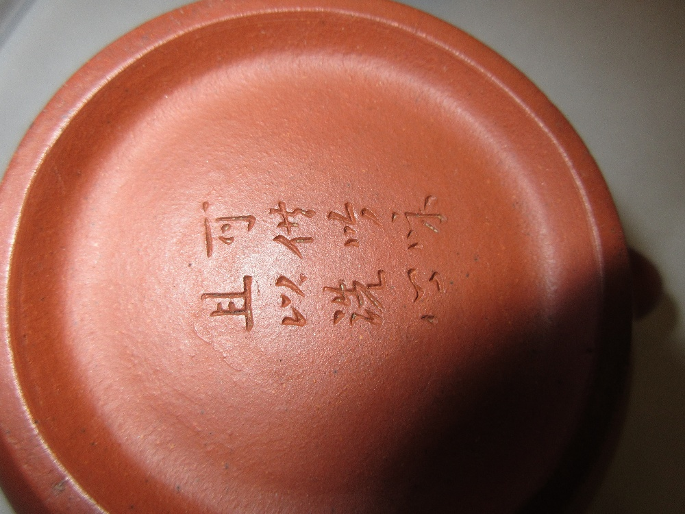 Lot 720 - 19th Century Chinese terracotta teapot and cover with incised eight character mark to the base Small
