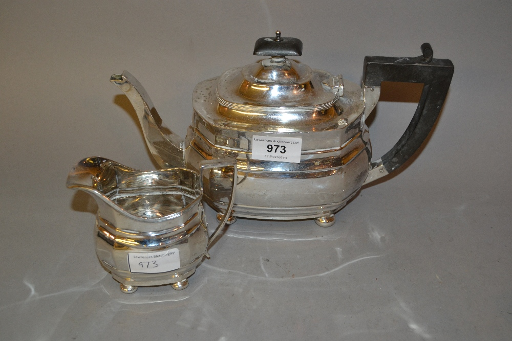 Lot 973 - 20th Century Chester silver teapot in Georgian style together with a similar Birmingham silver cream