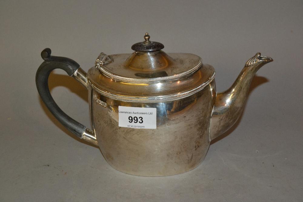 Lot 993 - Victorian oval Sheffield silver teapot in George III style
