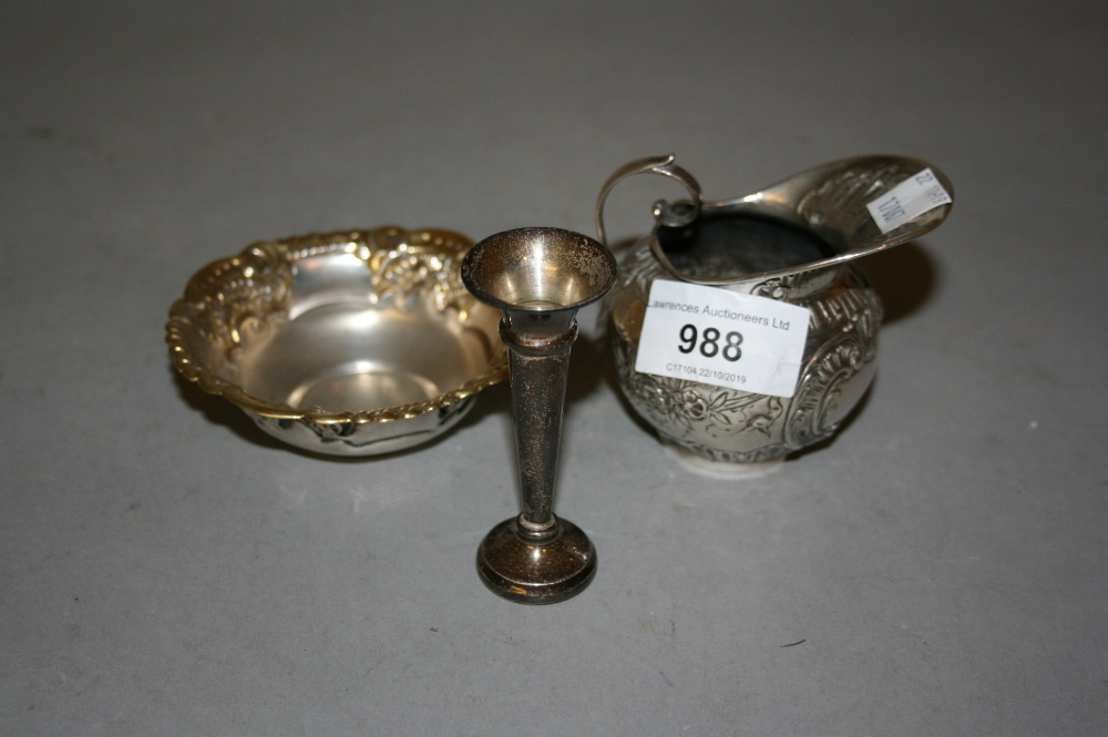 Lot 988 - Small London silver floral embossed jug, miniature silver spill vase and a small Continental