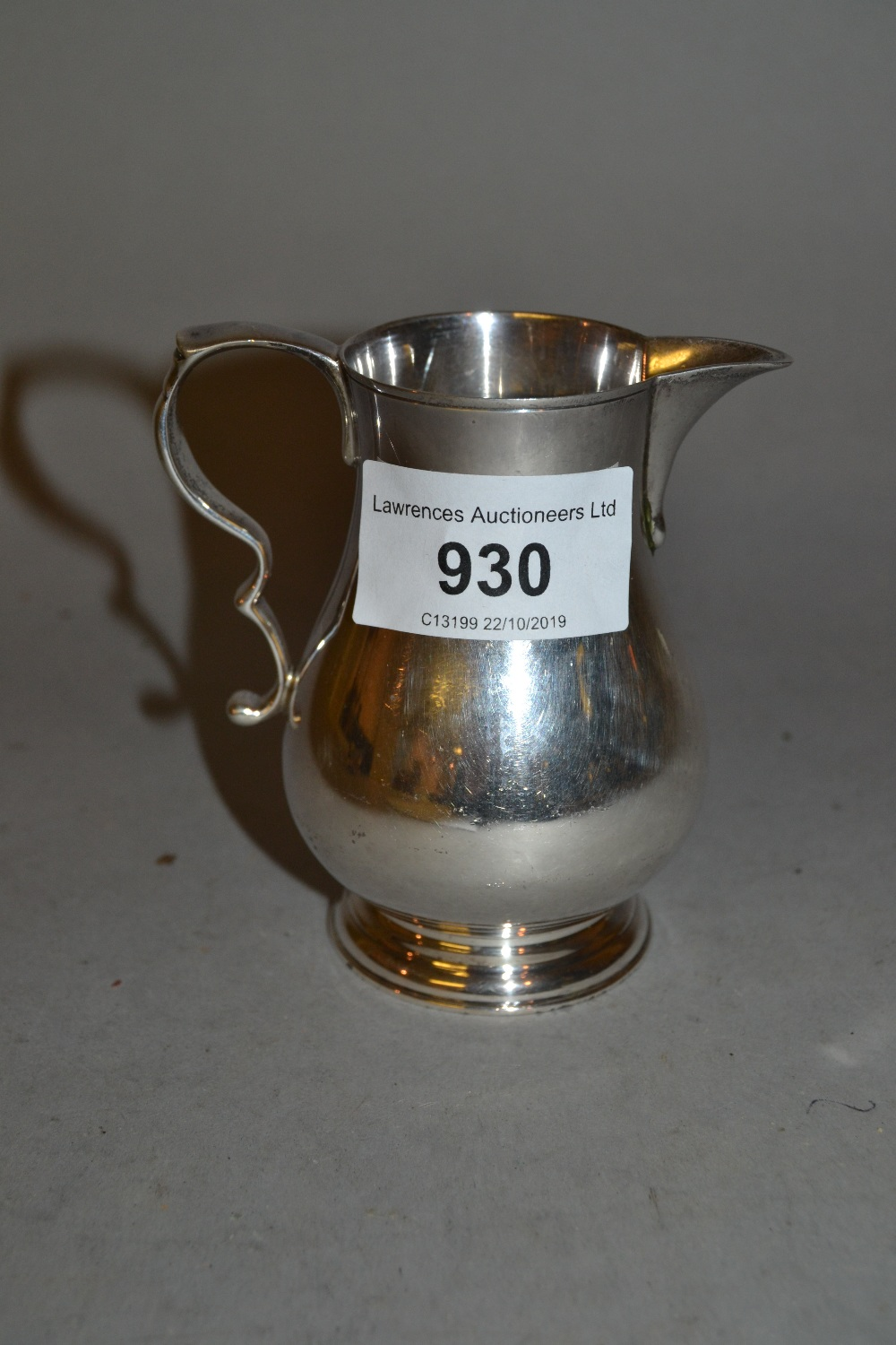 Lot 930 - Small silver cream jug in 18th Century style by Elkington and Co.