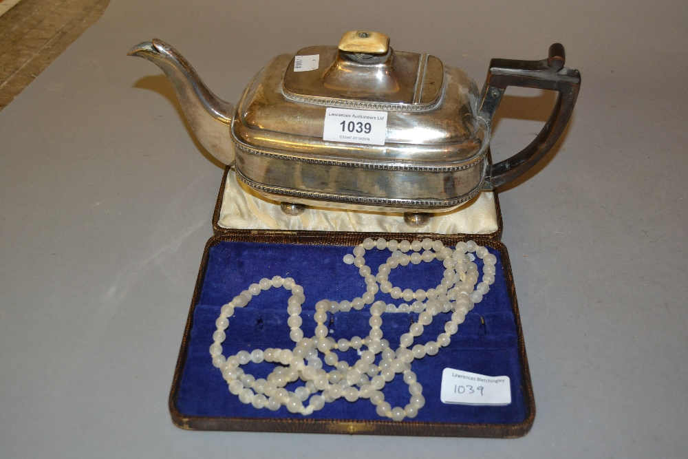 Lot 1039 - 19th Century silver plate on copper teapot with boxwood handle, together with a long glass bead