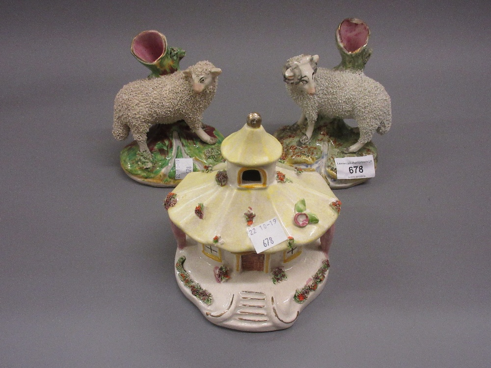 Lot 678 - Pair of 19th Century Staffordshire spill vases in the form of a ram and ewe, together with a
