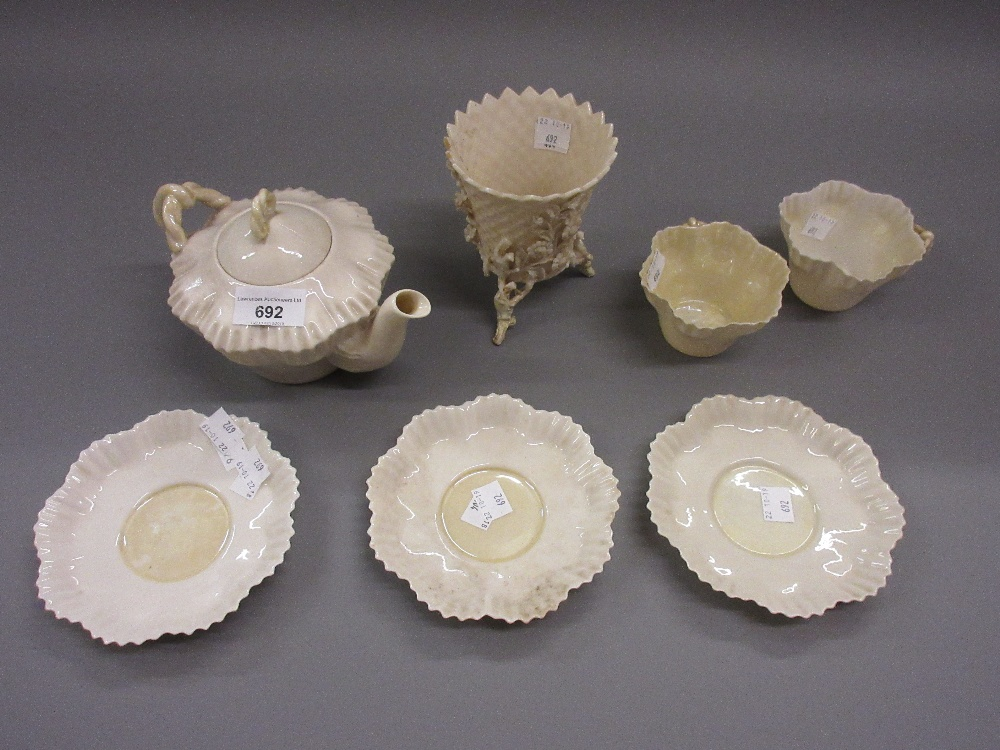 Lot 692 - Belleek plain white glazed teapot (black mark) together with four matching cups and saucers, Belleek