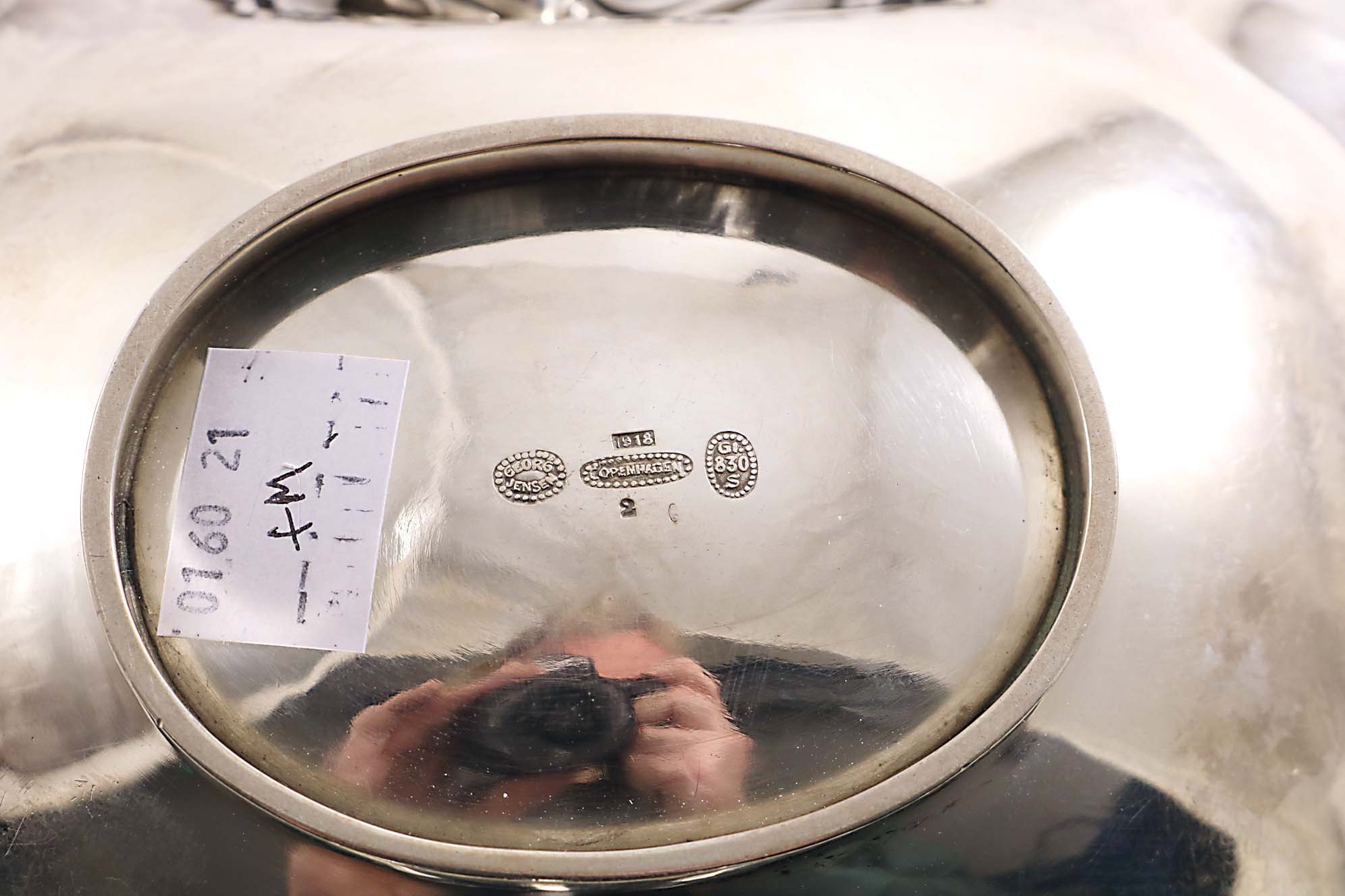Lot 469 - A SMALL COLLECTION OF PIECES BY GEORG JENSEN OF COPENHAGEN:- An early 20th century Danish dish of