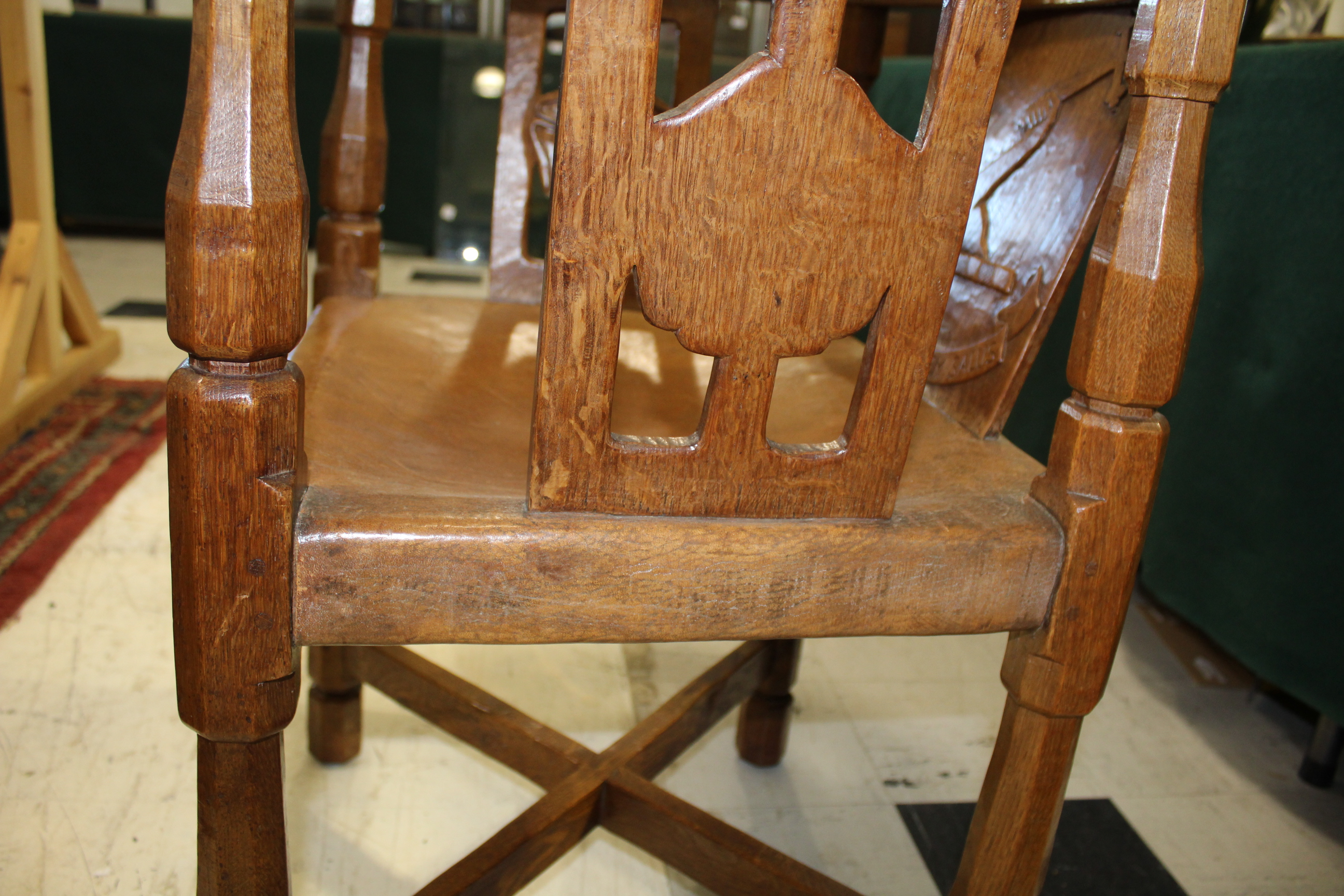 ROBERT THOMPSON OF KILBURN - MOUSEMAN MONKS CHAIR a circa 1920s/1930s oak Monk's armchair with a - Image 12 of 27