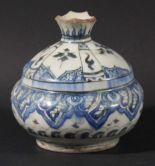 Lot 1490 - PERSIAN IZNIK VASE, perhaps 18th century, of ovoid form with a short neck, with panels of stylised