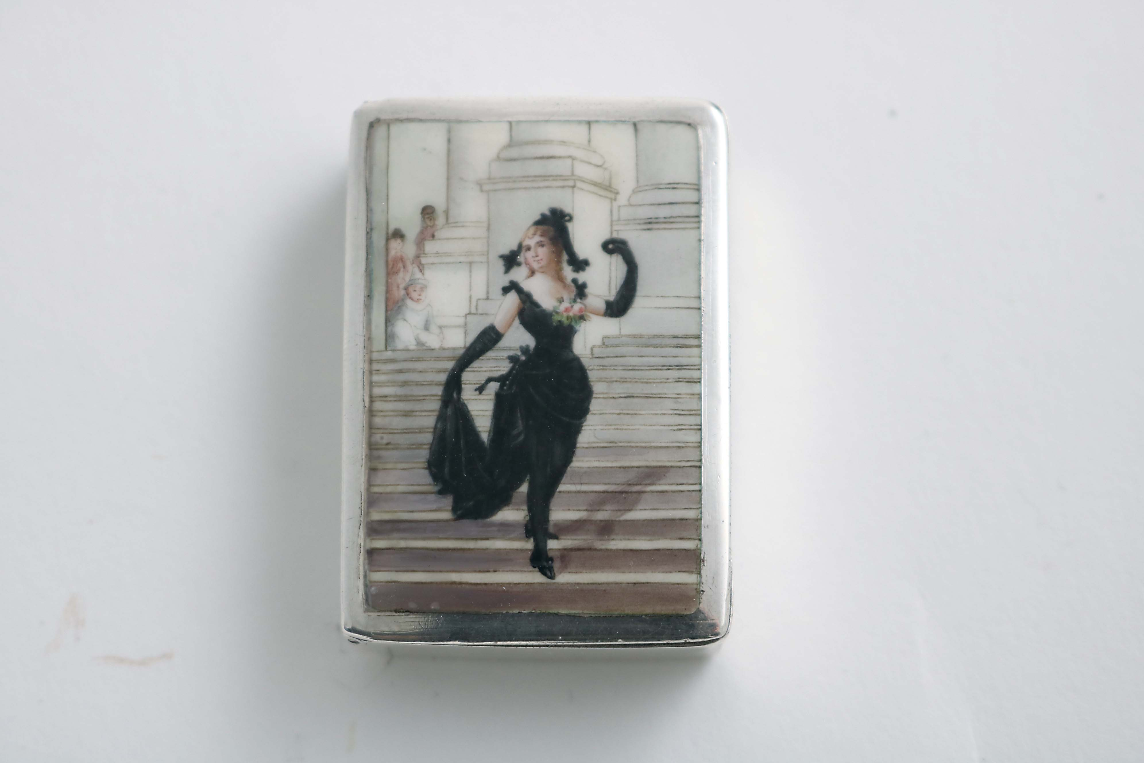 Lot 402 - THEATRICAL INTEREST:- A Victorian rectangular vesta case, enamelled on the cover with an image of