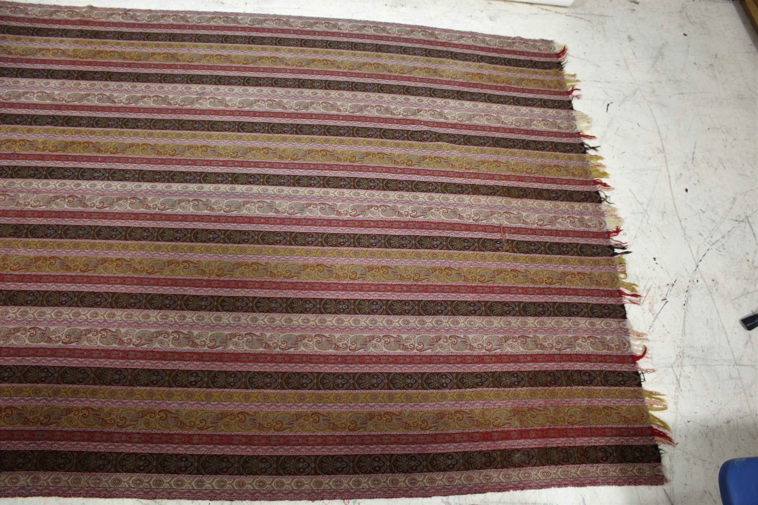 Lot 1908 - LARGE PAISLEY SHAWL a large wool shawl with repeating floral motifs within horizontal bands, and