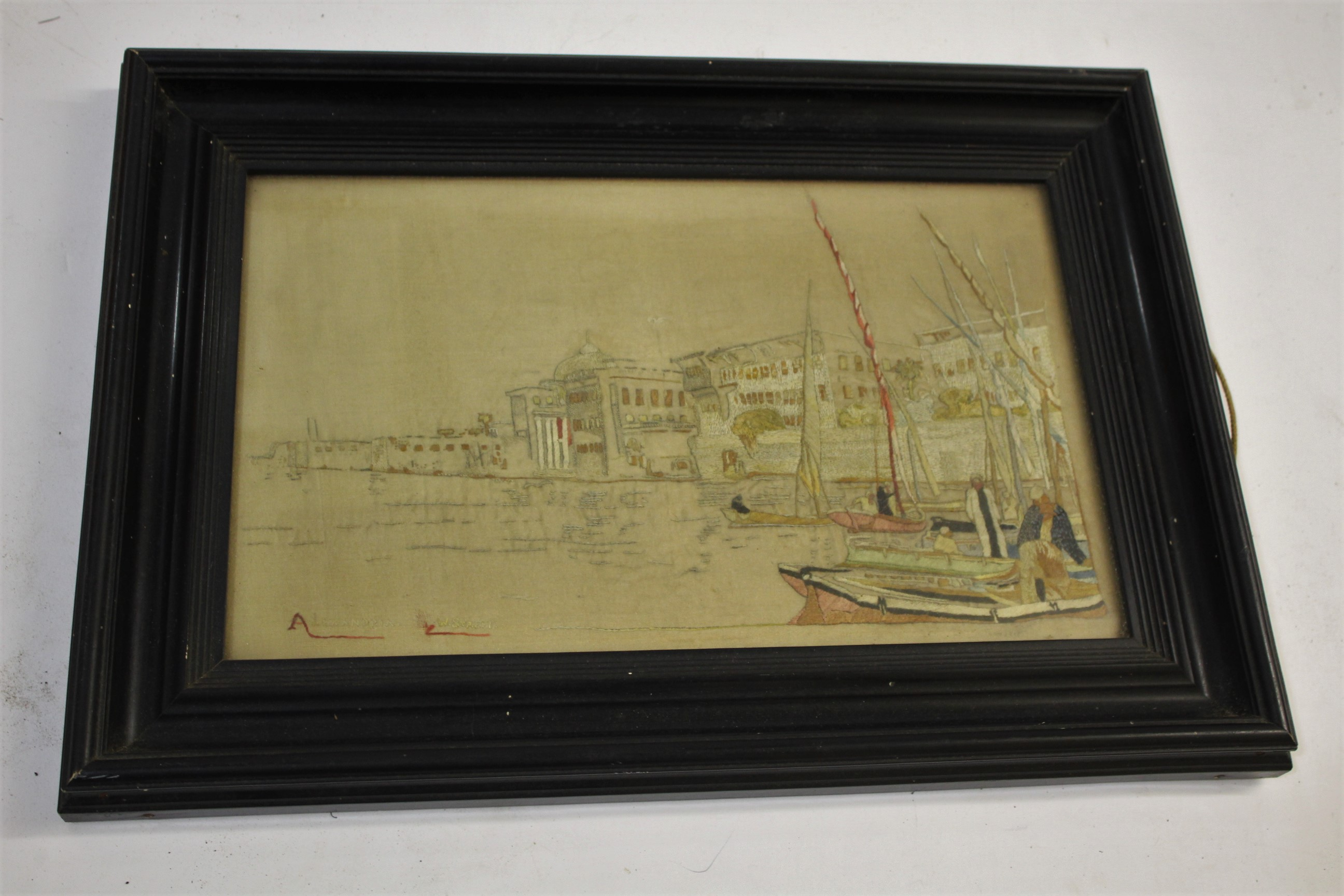 Lot 1879 - EMBROIDERED PICTURE OF ALEXANDRIA - W STREET an embroidered panel of a scene in Alexandria, signed
