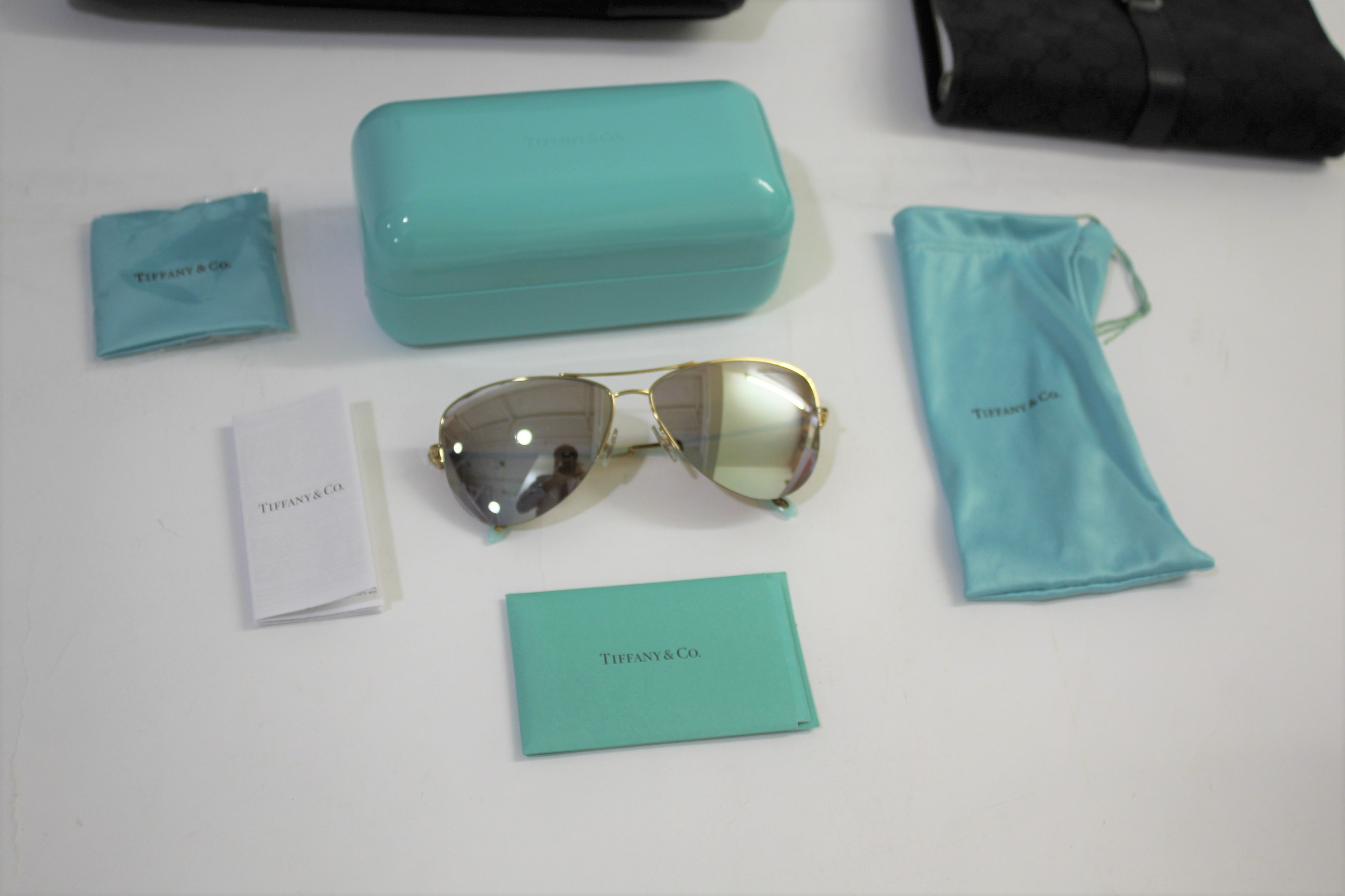 Lot 1907 - GUCCI & TIFFANY including a pair of Tiffany & Co sunglasses, in a turquoise case and with various