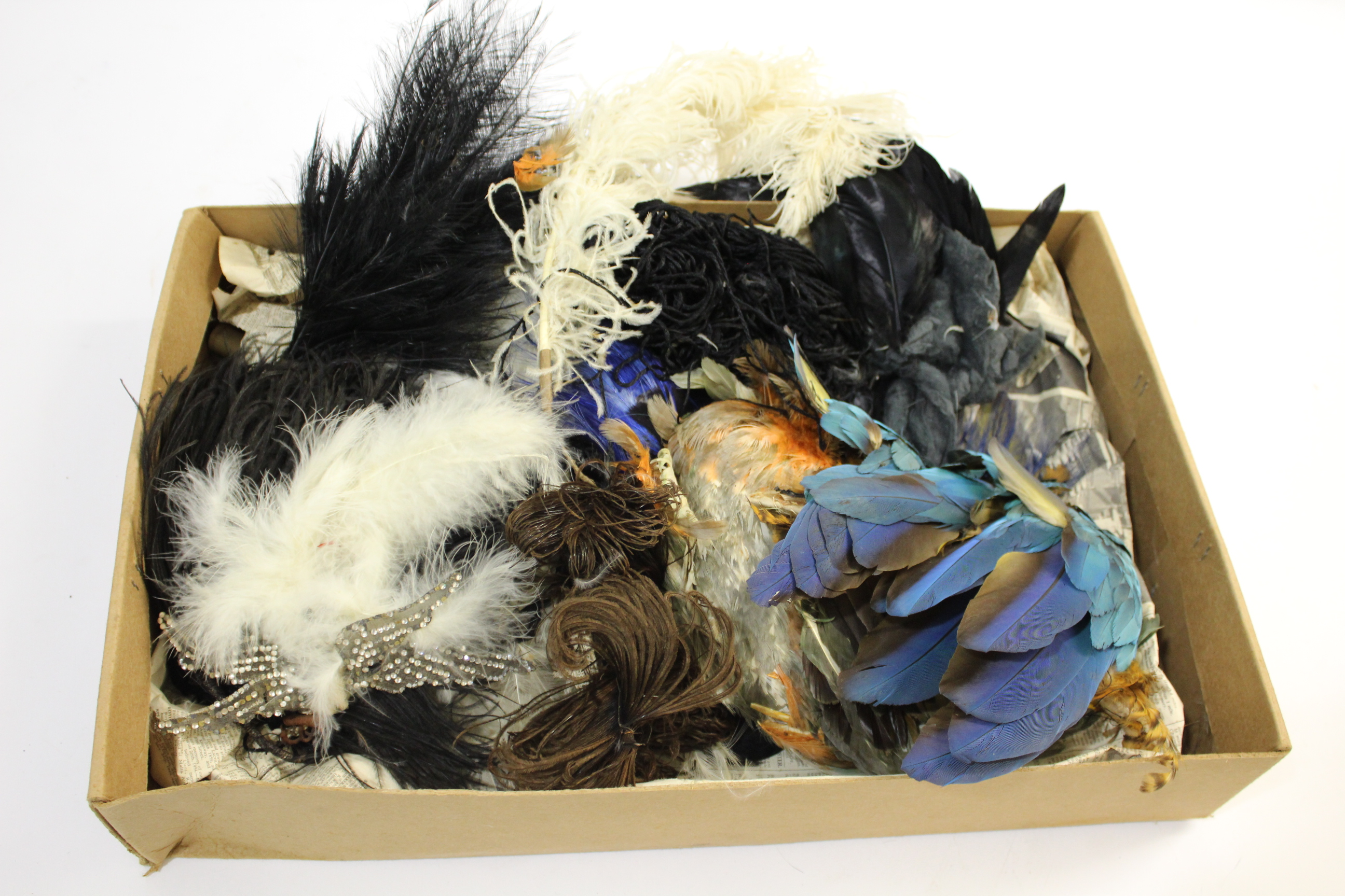 Lot 1897 - VINTAGE MILLINERY FEATHERS & CORSAGE a qty of late 19th and early 20th millinery feathers, and a