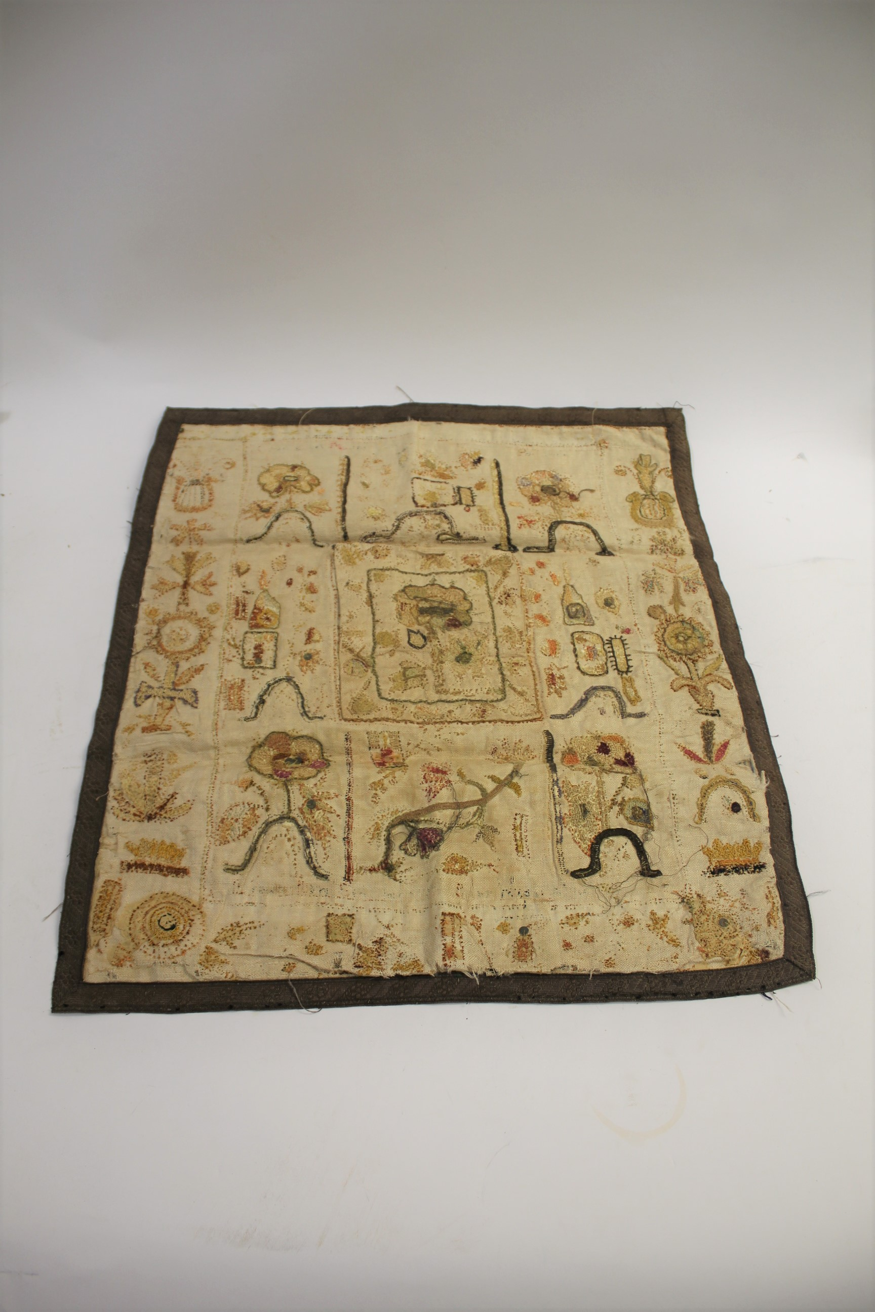 Lot 1868 - RARE 17THC SPOT SAMPLER a spot sampler onto linen with various flowers depicted, including a later