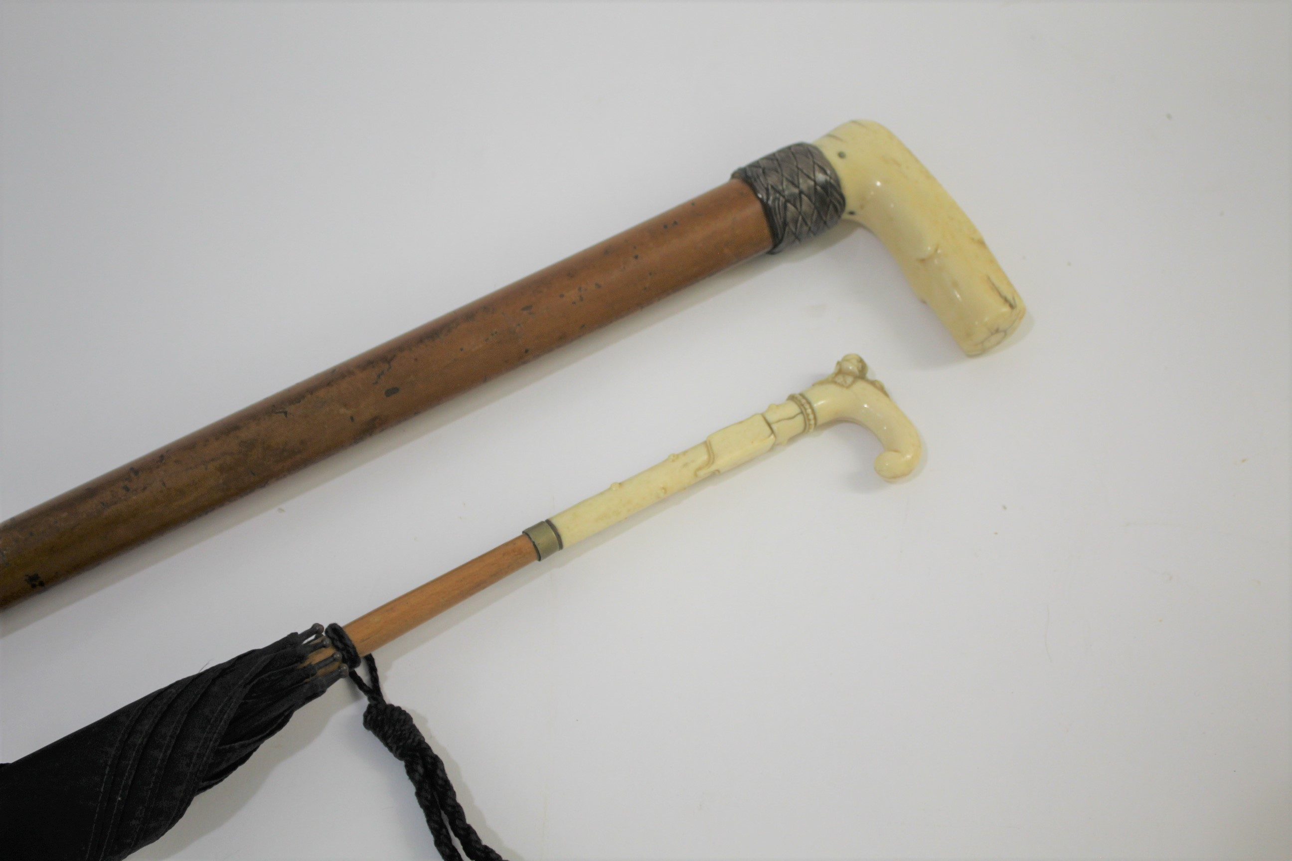 Lot 1850 - IVORY HANDLED PARASOL - BRIGG the ivory handle carved with flowers and leaves and with a black