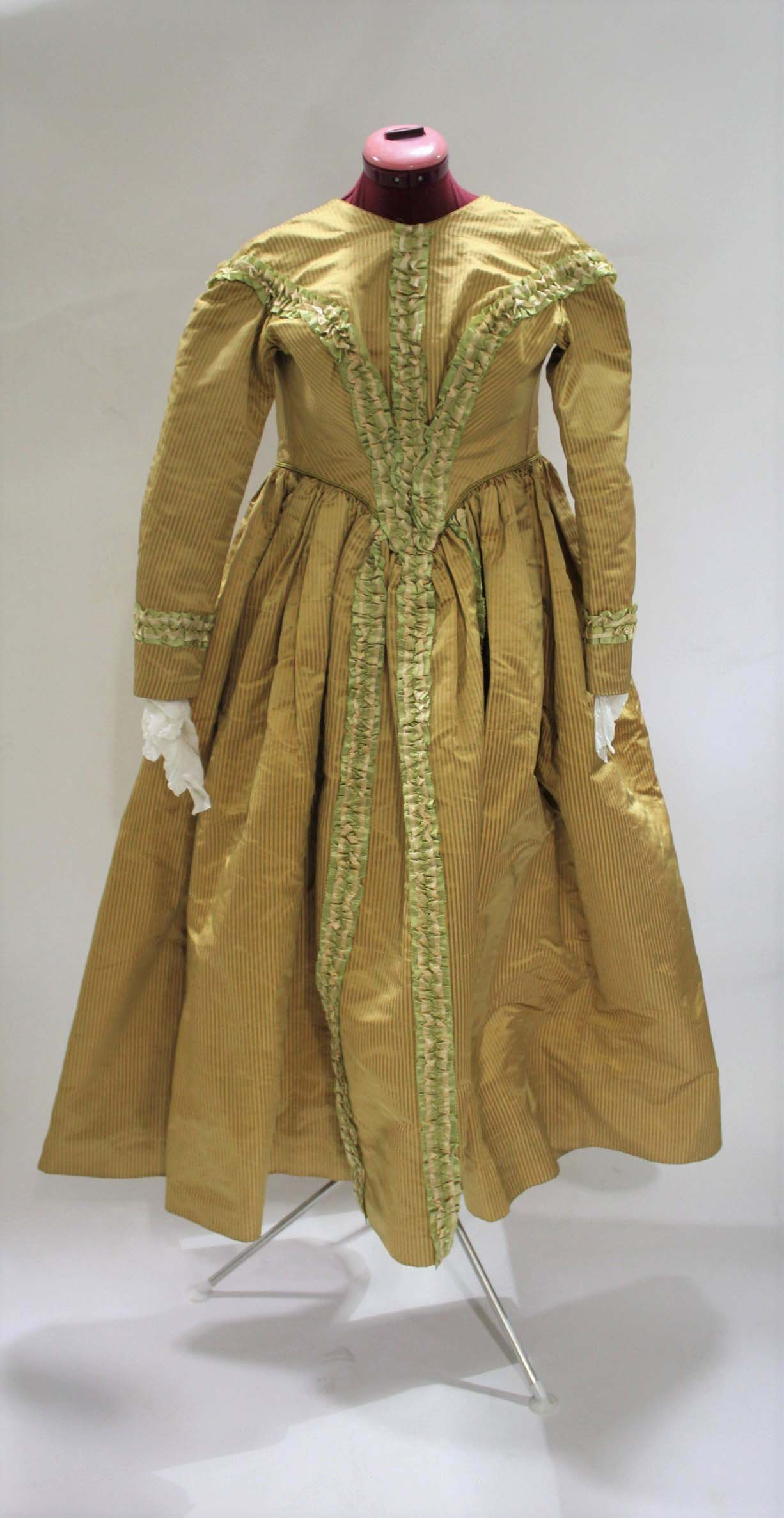 Lot 1866 - 19THC SILK LADIES DRESS a mid 19thc apricot and olive green striped silk dress, decorated with