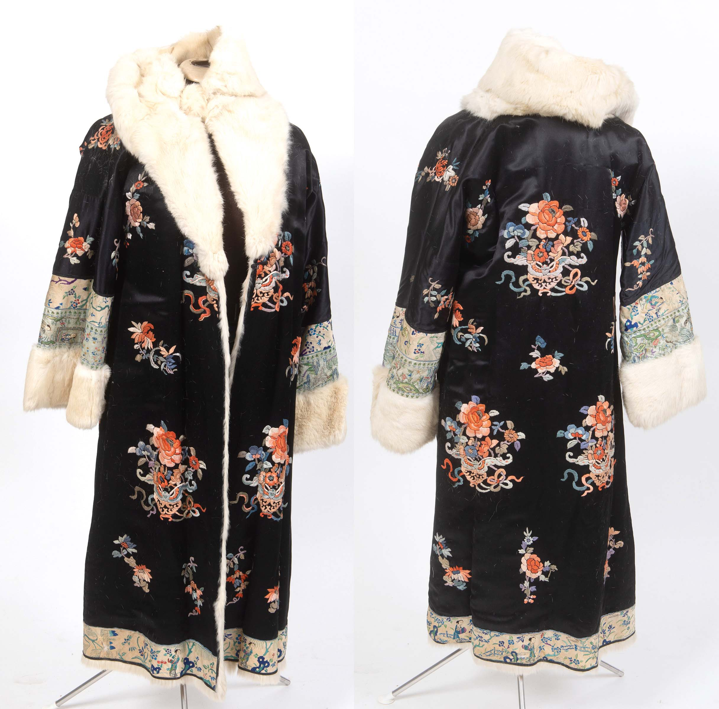 Lot 1884 - CHINESE FUR LINED EMBROIDERED COAT a fur lined coat adapted from a black silk Chinese robe,