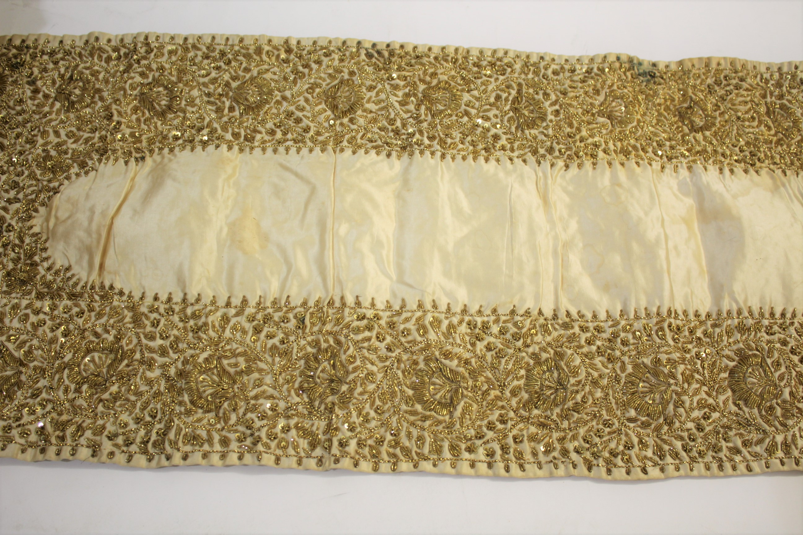 Lot 1898 - SILK EMBROIDERED PANEL possibly Indian, an early 20thc pale silk panel with silver coloured
