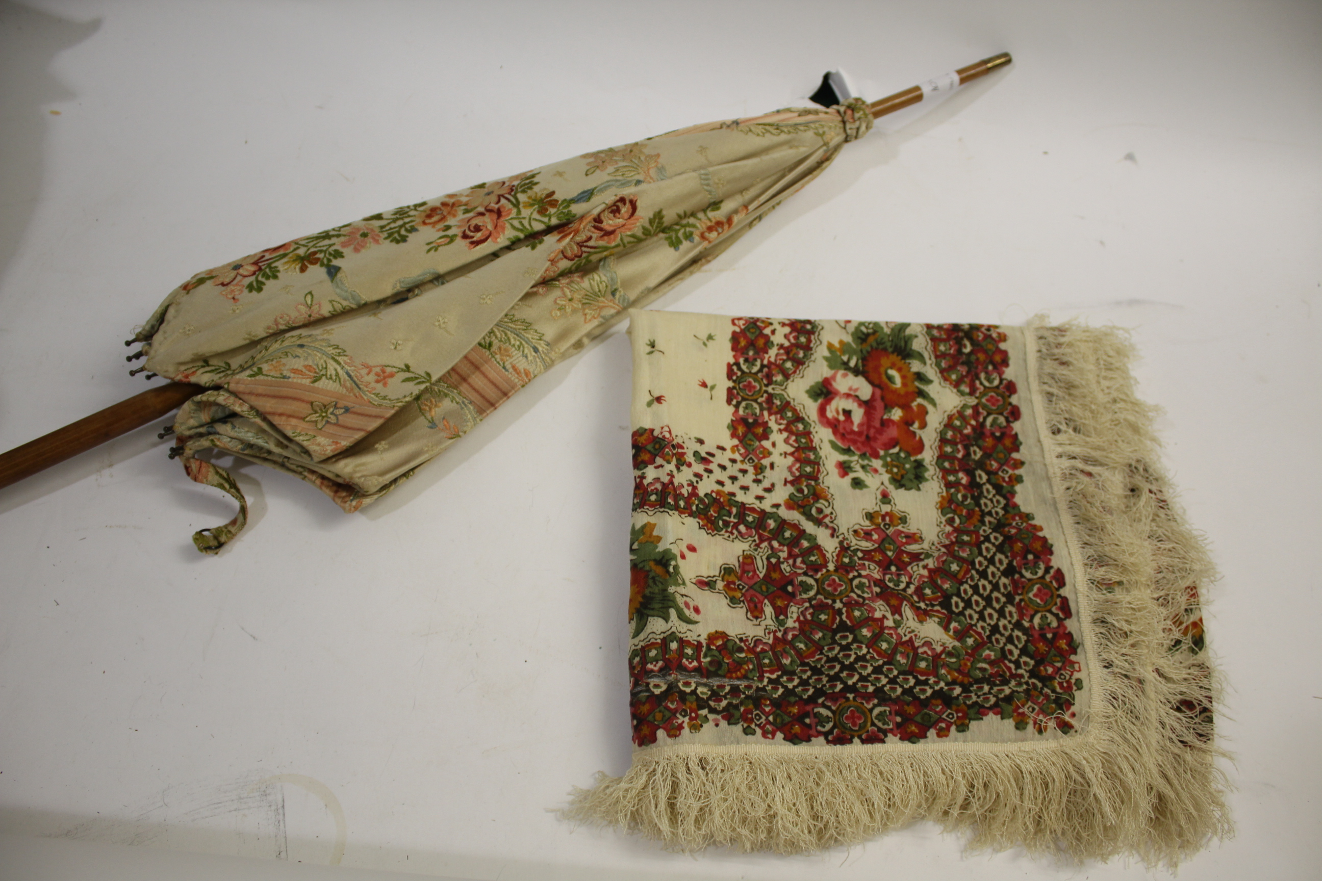 Lot 1878 - 19THC WOOL SHAWL a 19thc cream fine wool fringed shawl edged with a printed floral border, also with