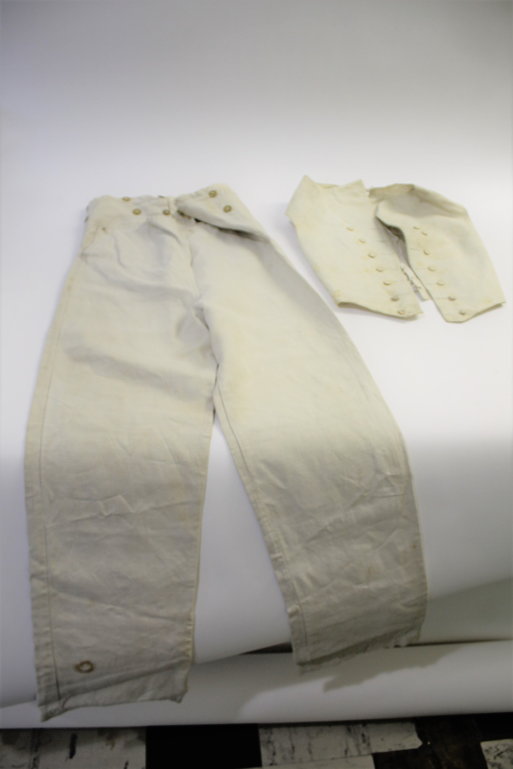 Lot 1861 - 19THC GENTS TROUSERS a pair of cream linen gentleman's trousers with brass button fastening, also