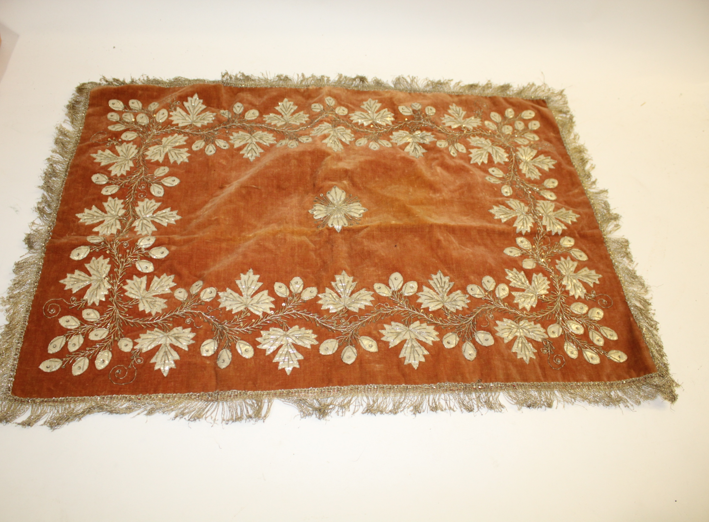 Lot 1895 - EMBROIDERED PANEL embroidered with flowers and leaves in metallic thread, mounted on velvet and with