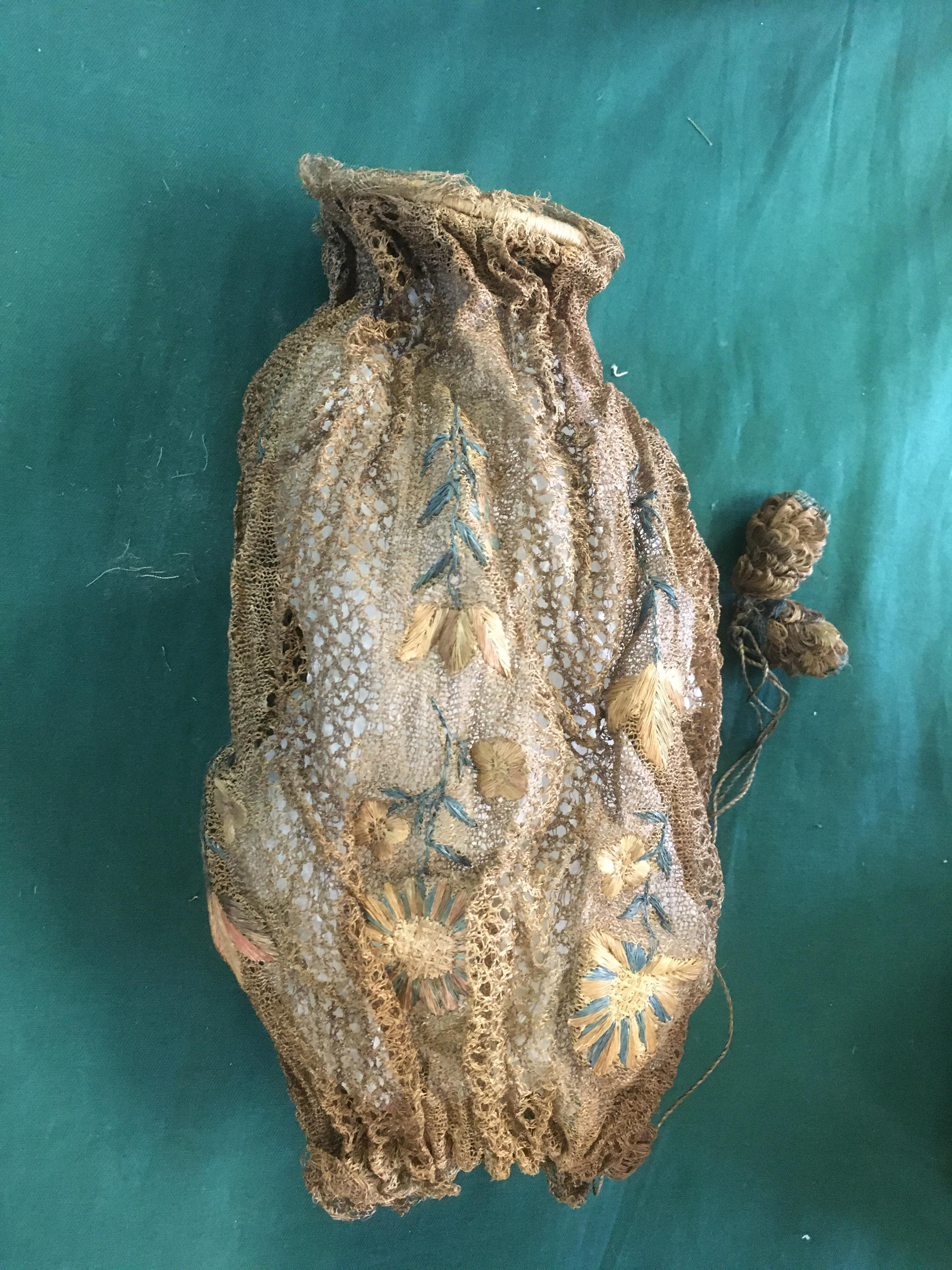 Lot 1867 - EARLY 19THC WOVEN DRAWSTRING BAG the bag decorated with raffia work flowers, also with an ivory silk