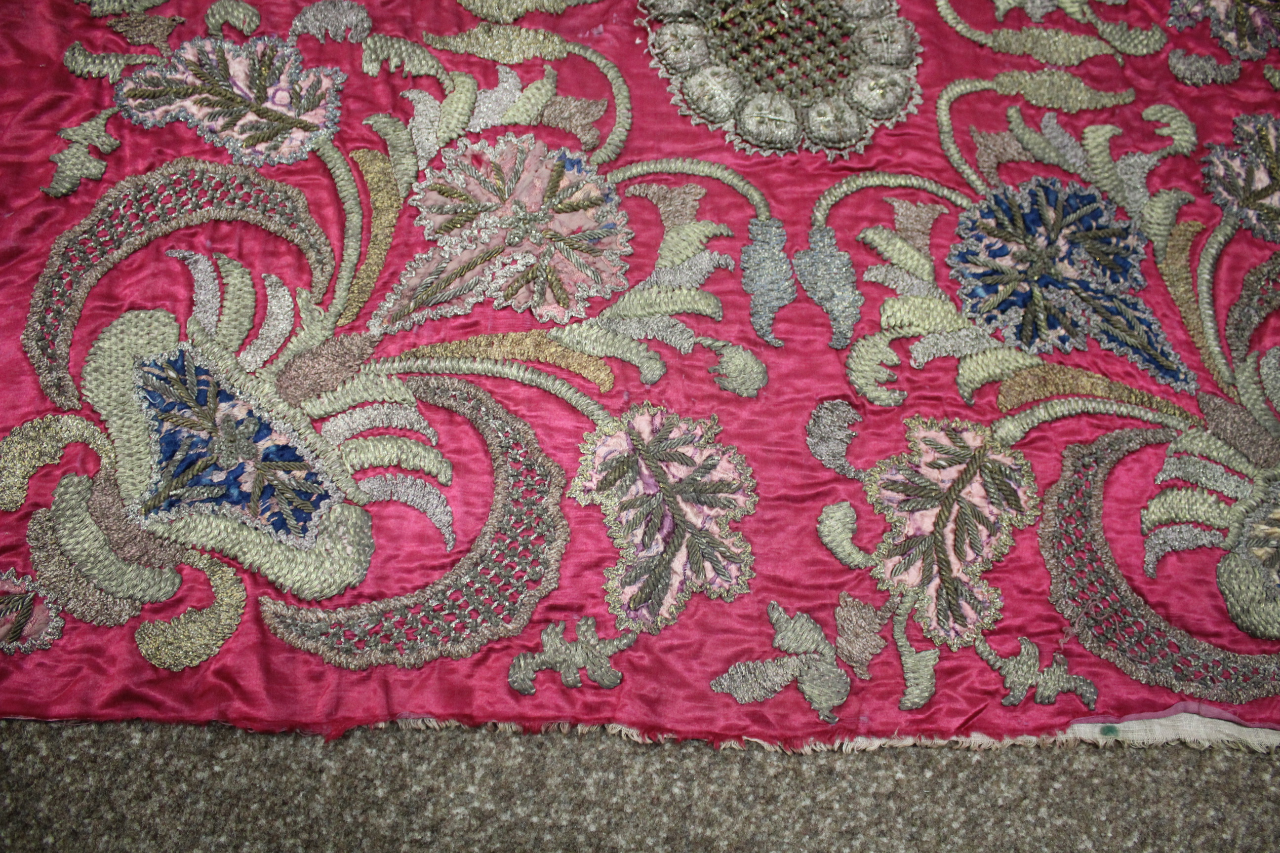 Lot 1885 - SILK TAPESTRY PANEL probably 18thc, a silk and metal thread panel working in various stitches on a