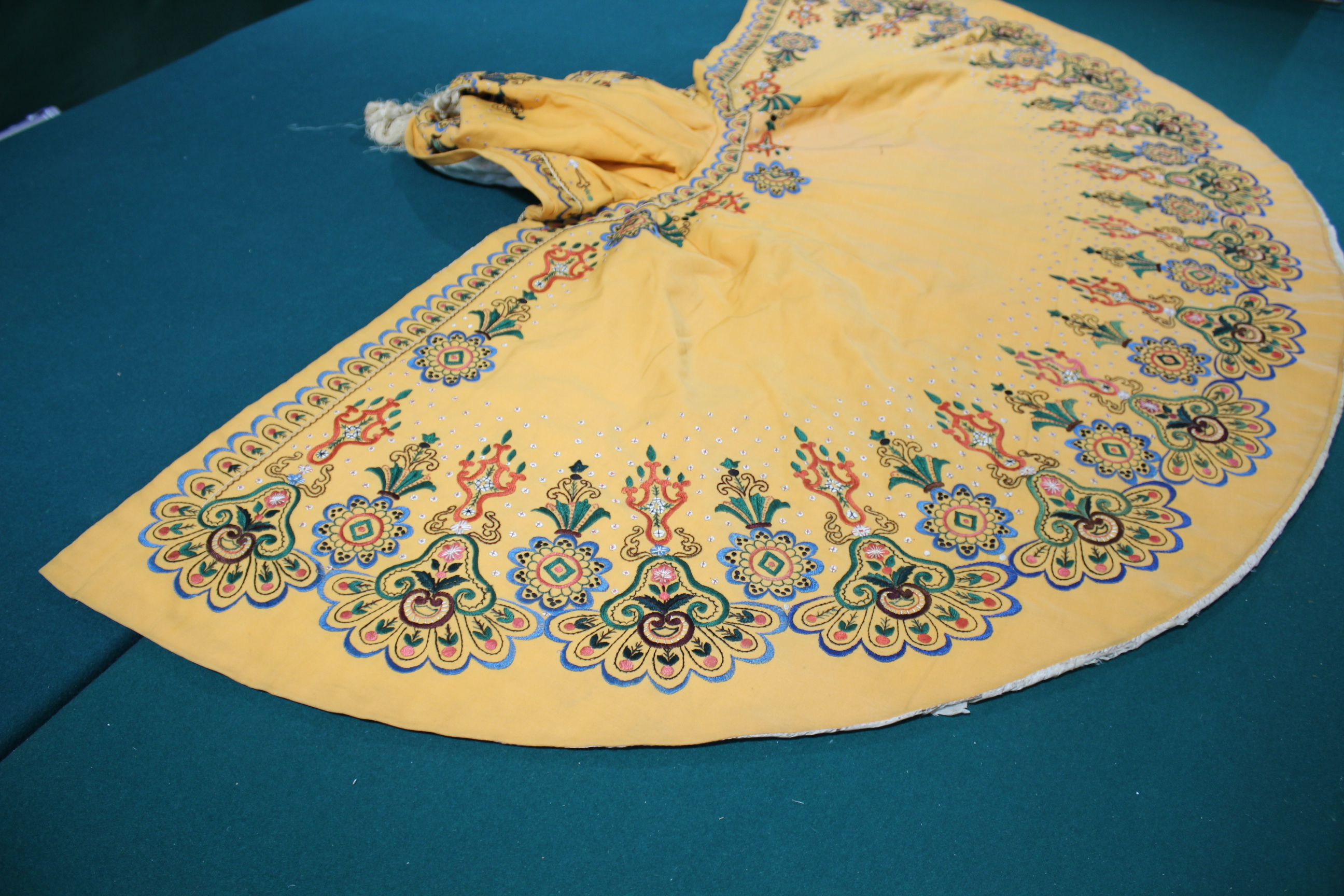Lot 1862 - EARLY 20THC CAPE probably Eastern European, the orange wool cape lined with ivory coloured silk, and