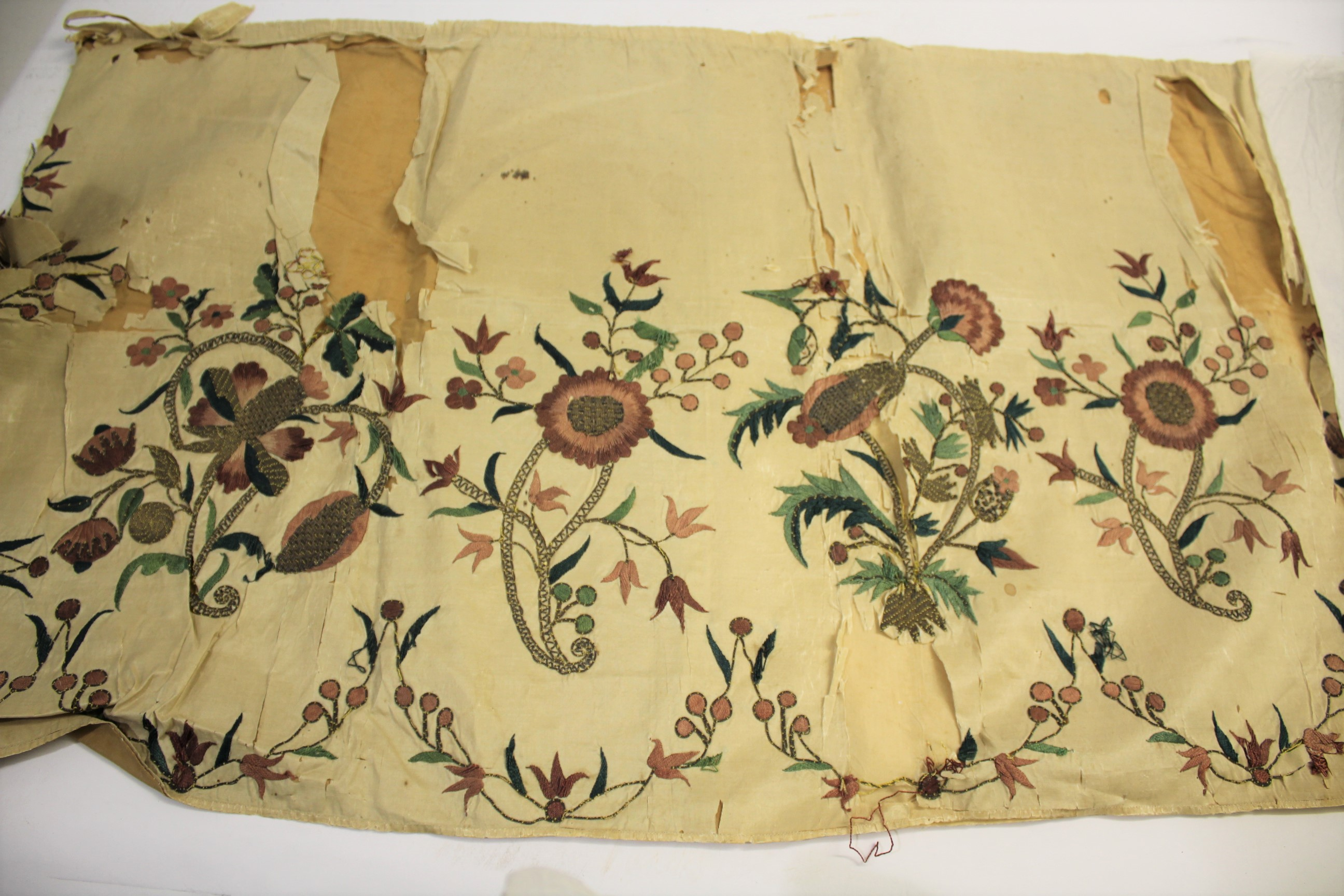 Lot 1869 - 18THC CREAM SILK PANEL decorated with an embroidered flowing design of flowers and leaves, worked in