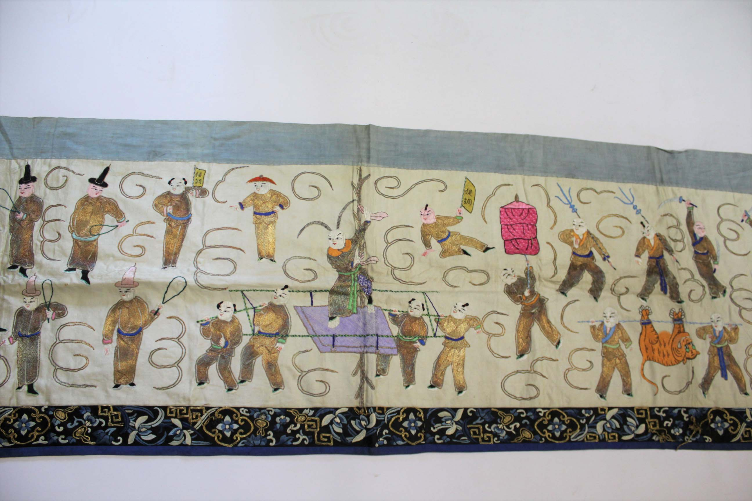 Lot 1881 - CHINESE SILK TABLE RUNNER early 20thc, the runner embroidered with various processional figures