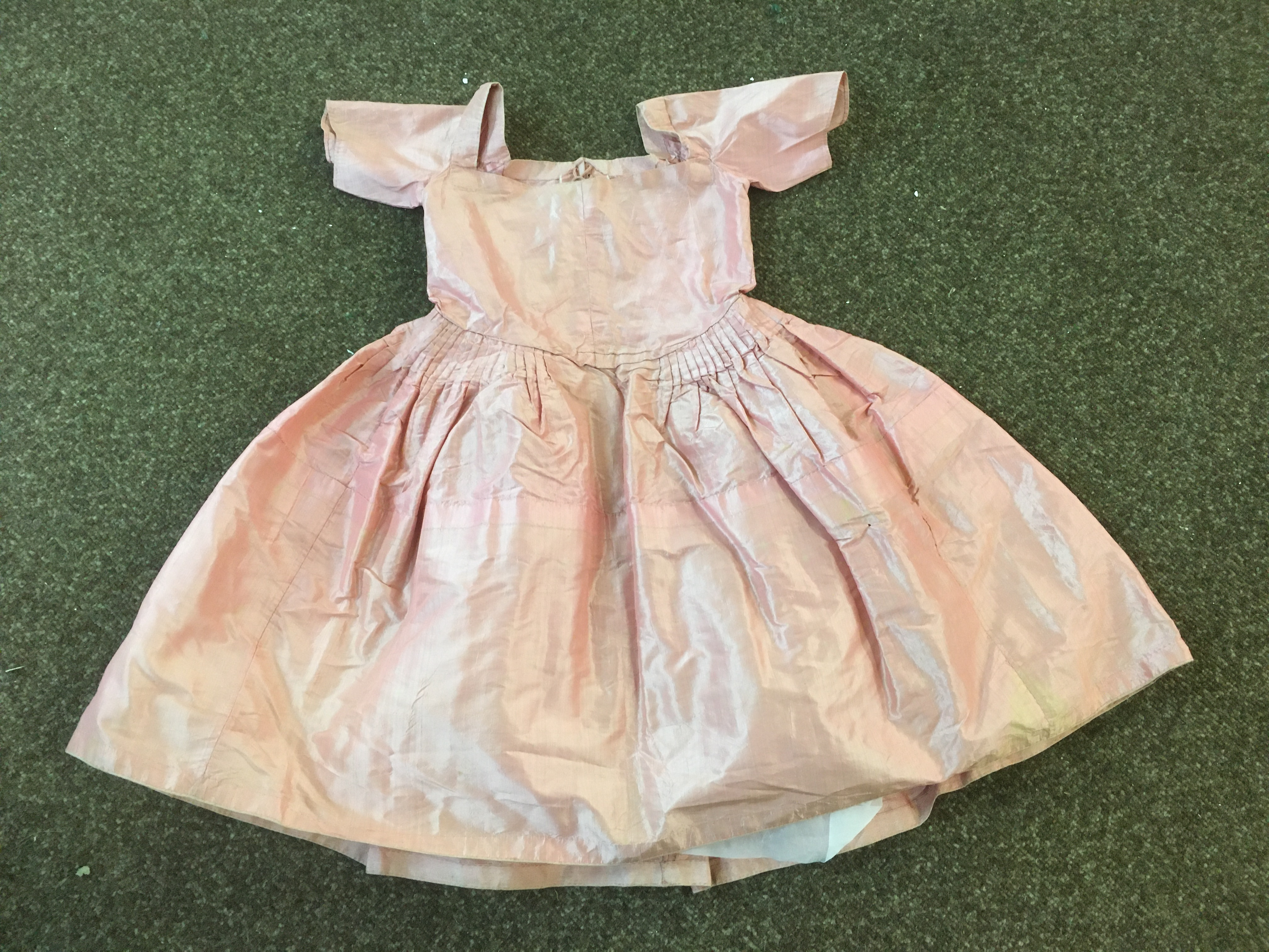 Lot 1863 - 18THC SILK CHILD'S DRESS a silk child's dress, pleated to the waist with lace fastening bodice (