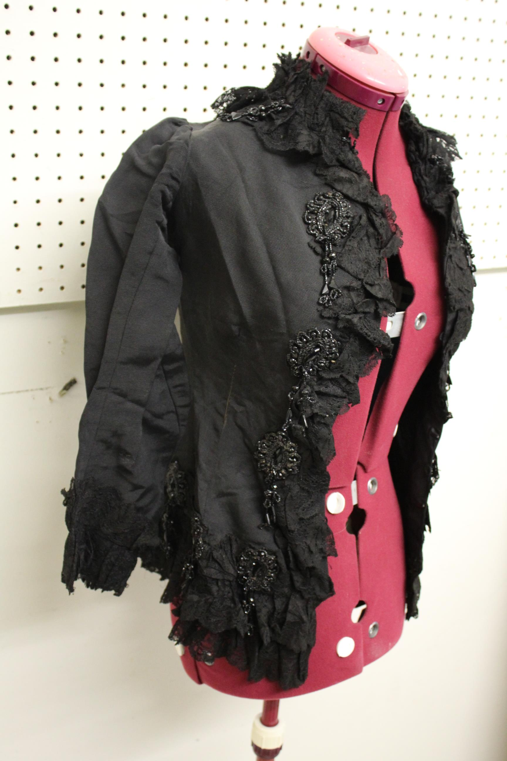 Lot 1880 - 19THC JACKET a black grosgrain jacket embellished with lace and bead embroidered motifs, by Cole