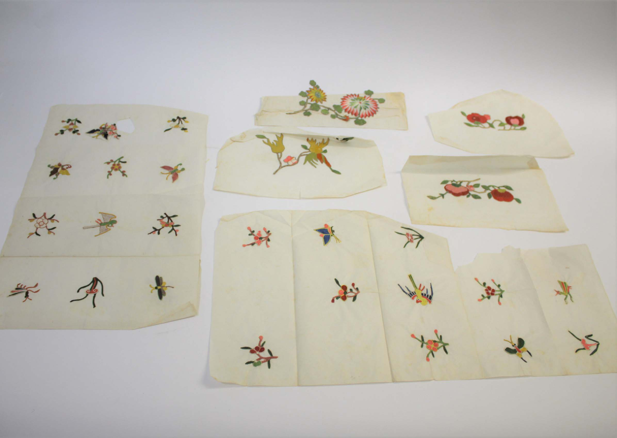 Lot 1855 - 19THC CHINESE SILK EMBROIDERIES a qty of late 19thc Chinese applique silk embroideries of plants,