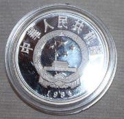 """China 1984, 5 Yuan - Silbermünze """"Terrakotta - Reiter"""". Silber 900. Gewicht: 22,2 gr.. In Kapsel."""