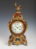 Lot 210A - A 19th century Rococo style Boulle work and ormolu mounted mantle clock, with circular Arabic and