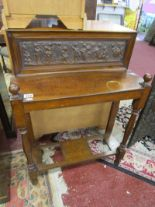 Lot 302 - Small hall table with ornately carved back panel