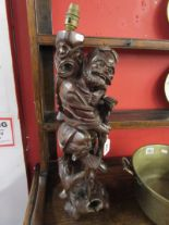 Lot 261 - Oriental carved lamp