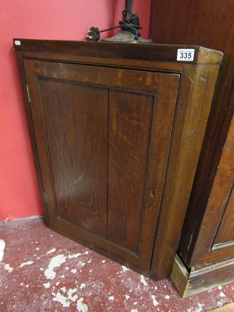 Lot 335 - Georgian oak corner cupboard