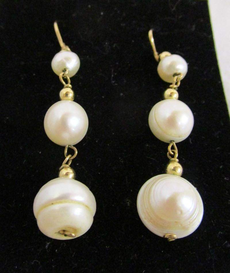 Lot 28 - Pair of gold triple pearl drop earrings