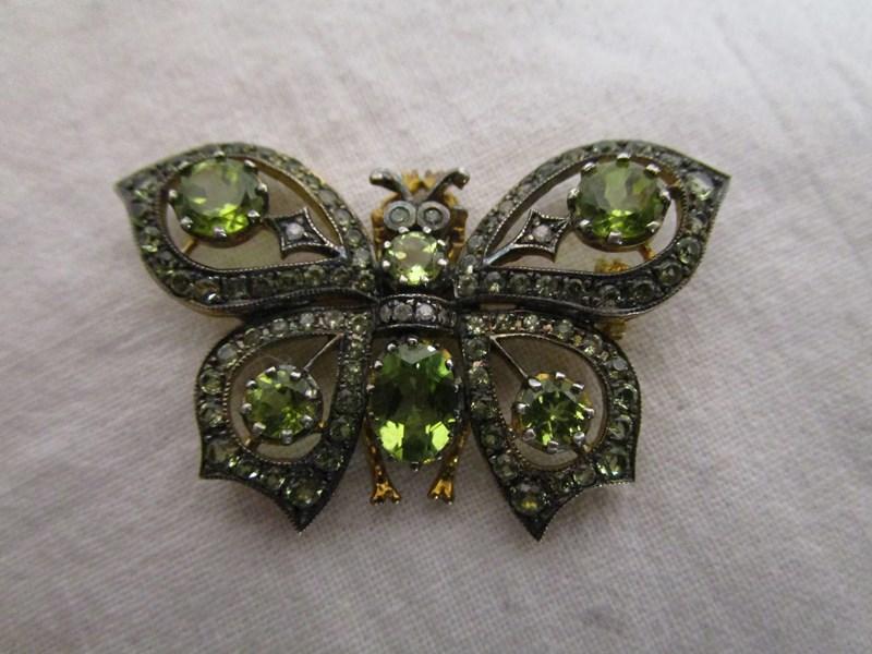 Lot 17 - Peridot & diamond butterfly brooch