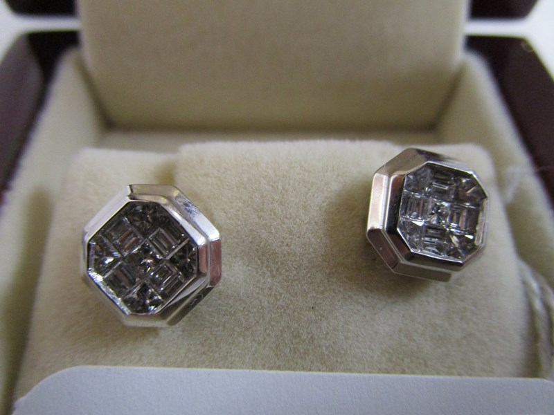 Lot 31 - Pair of 18ct white gold princess cut diamond set earrings