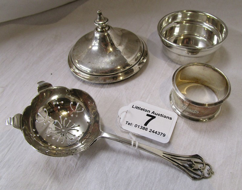 Lot 7 - Hallmarked silver straining spoon, napkin ring and bowl