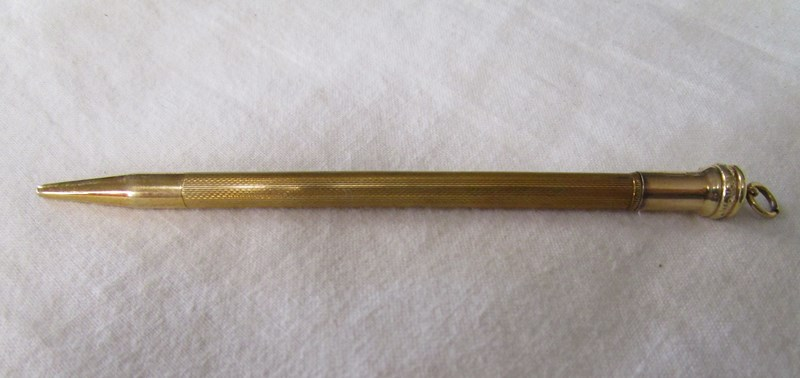 Lot 9 - Birmingham hallmarked gold propelling pencil in box with blank cartouche