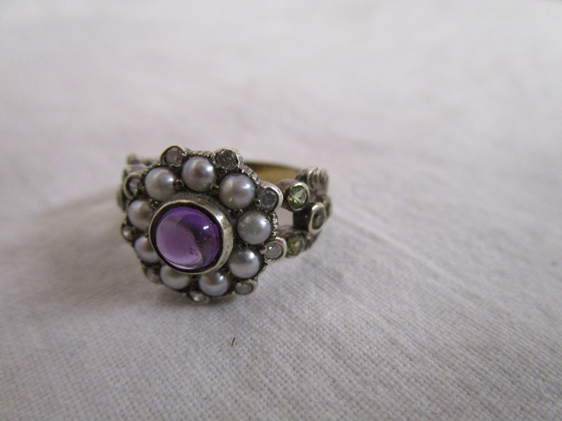 Lot 23 - Amethyst, pearl, diamond & peridot ring